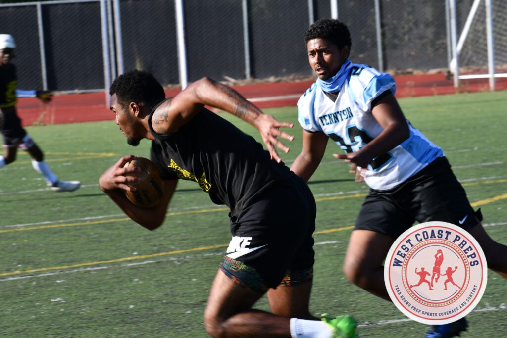 Elijah Jackson runs with the football for Fremont in Castlemont's 7-on-7 Tournament on July 22, 2021. Chris Jackson / Staff Photo